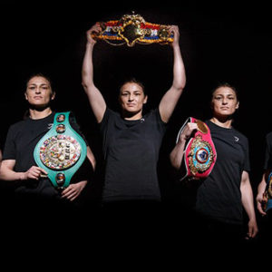 Katie Taylor with 5 belts