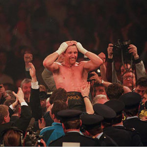 Stephen Collins celebrates after beating Chris Eubank for the W.B.O supermiddle-weight title.