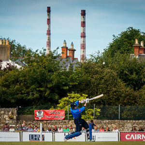 Cricket match in Dublin in front of chimney stacks