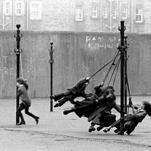 Children in inner city Dublin play on the street in 1974 - Buckingham Street.