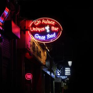 The Gin Palace sign illuminates Liffey Street.