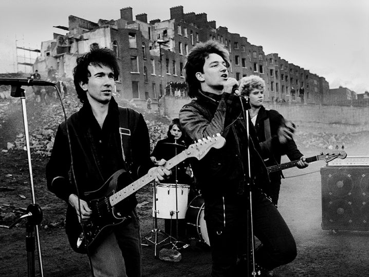 U2 on the set of the Celebration video at Gardiner Street in Dublin. This was at the demolition of Summerhill in the city centre.Performed ( mimed ) Gloria used in the October album in 1981