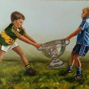 Boy wearing Kerry jersey and a boy in a Dublin jersey pulling the Sam Maguire off each other.