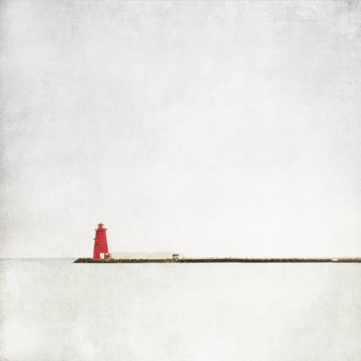 The iconic poolbeg lighthouse stands guard in Dublin bay