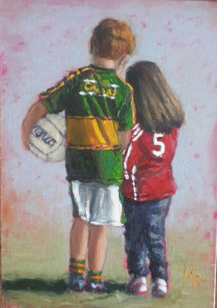 Kerry boy with football and Cork girl.